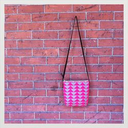 """<strong>Early Girl Ink</strong> Small Hip Sack Pink and Olive Balancing Act Print, <a href=""""http://www.earlygirlink.com/product/small-hip-sack-pink-and-olive-balancing-act-print"""">$45</a>"""