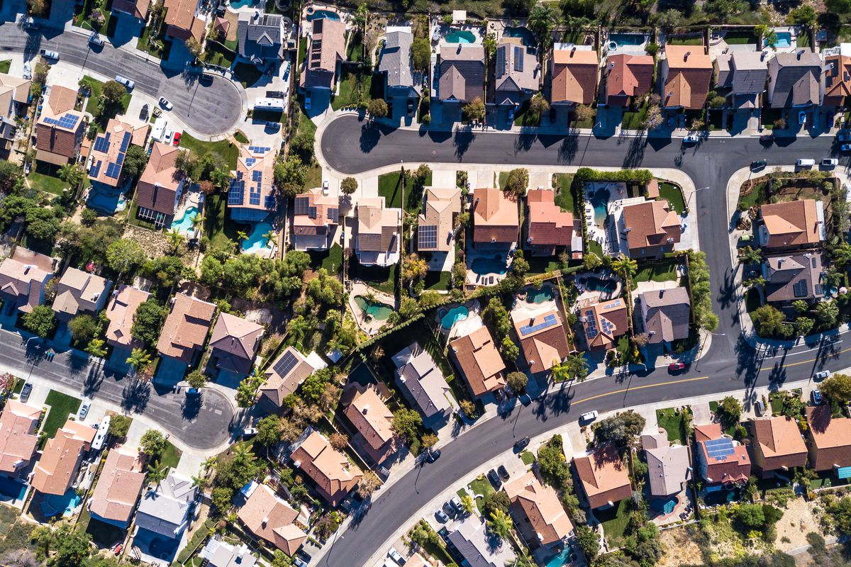 Aerial view of rows of houses.