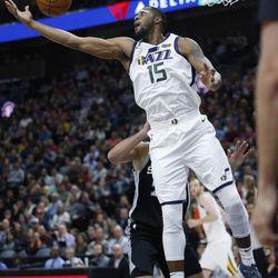 Utah Jazz forward Derrick Favors (15) grabs a rebound in Salt Lake City on Thursday, Dec. 21, 2017.