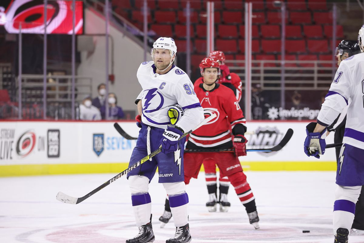 Steven Stamkos #91 of the Tampa Bay Lightning prepares for a face-off against Sebastian Aho #20 of the Carolina Hurricanes during an NHL game on February 22, 2021 at PNC Arena in Raleigh, North Carolina.