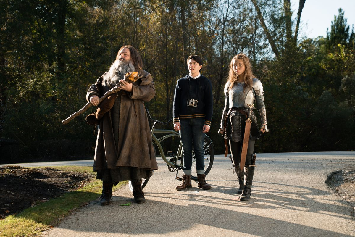 "Joel McCrary, from left, Sloane Siegel and Caitlin Carmichael in a scene from BYUtv's ""Dwight in Shining Armor."""