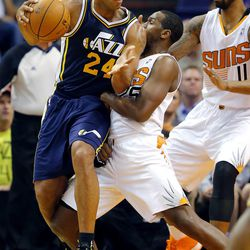 Utah Jazz forward Richard Jefferson (24) backs down Phoenix Suns' Dionte Christmas during the second half of an NBA basketball game on Friday, Nov. 1, 2013, in Phoenix. The Suns won 87-84.