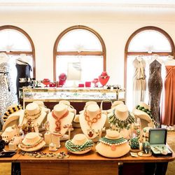 More jewelry, flanked by dresses left to right: Naeem Kahn, Oscar de la Renta, Christian Dior, Lanvin, Badgley Mischka, Halston