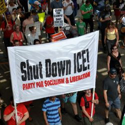 Protesters march down Clark Street onSaturday to protest anticipated raids by immigration officials.