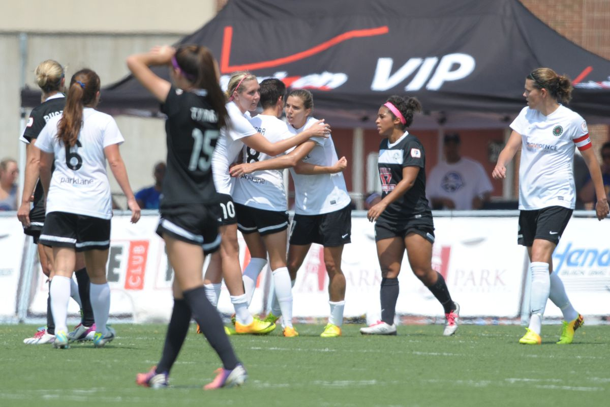 Portland Thorns midfielder Tobin Heath  is congratulated by teammates after scoring a goal during the first half of the match against FC Kansas City.
