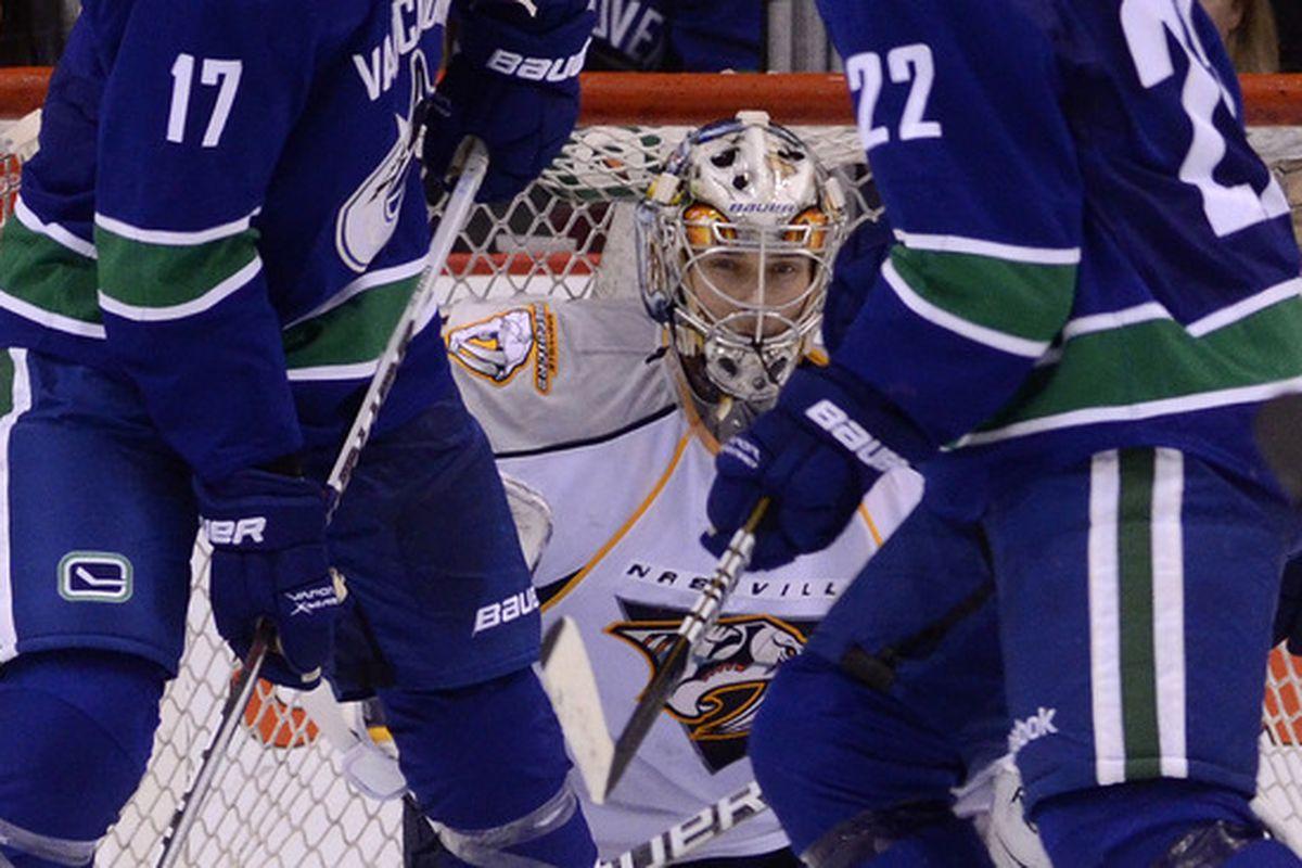 Pekka Rinne tries to hide from Raffi Torres.