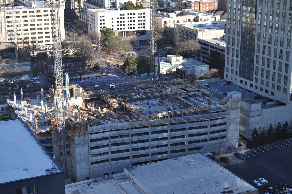 Seven stories of a concrete structure, seen from above.