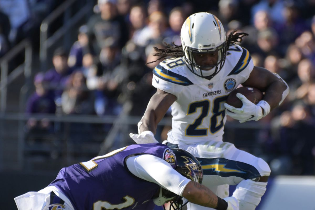 Los Angeles Chargers running back Melvin Gordon leaps over Baltimore Ravens cornerback Jimmy Smith during an AFC Wild Card playoff football game at M&T Bank Stadium.