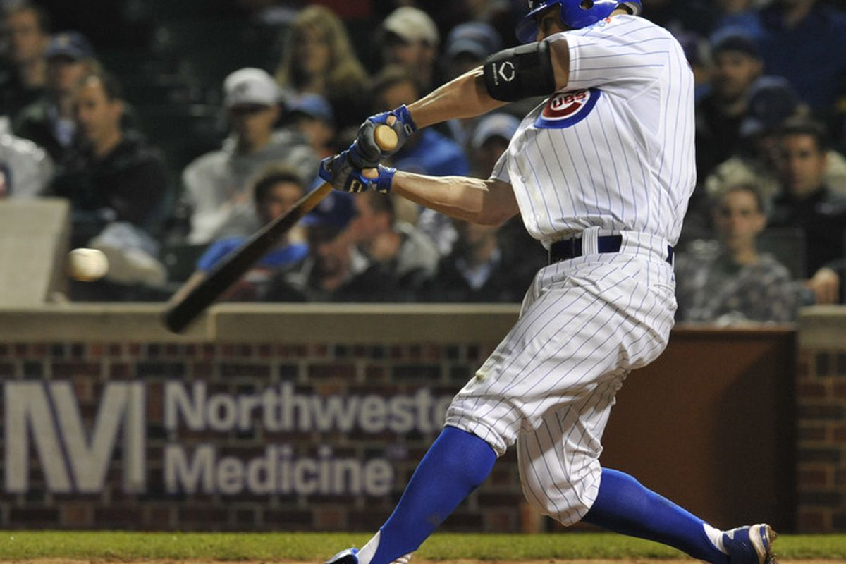 CHICAGO, IL - JUNE 15: Reed Johnson # 5 of the Chicago Cubs hits a 3-run homer against the Milwaukee Brewers in the fifth inning on June 15, 2011 at Wrigley Field in Chicago, Illinois.  (Photo by David Banks/Getty Images)