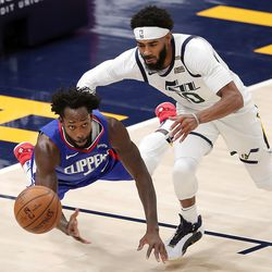 LA Clippers guard Patrick Beverley (21) and Utah Jazz guard Mike Conley (10) chase down the ball as the Utah Jazz and LA Clippers play in an NBA basketball game at Vivint Smart Home Arena in Salt Lake City on Friday, Jan. 1, 2021. Utah won 106-100,