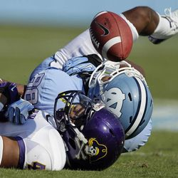 East Carolina's Maurice Falls, foreground, breaks up a pass intended for North Carolina's Erik Highsmith (88) during the first half of an NCAA college football game in Chapel Hill, N.C., Saturday, Sept. 22, 2012.