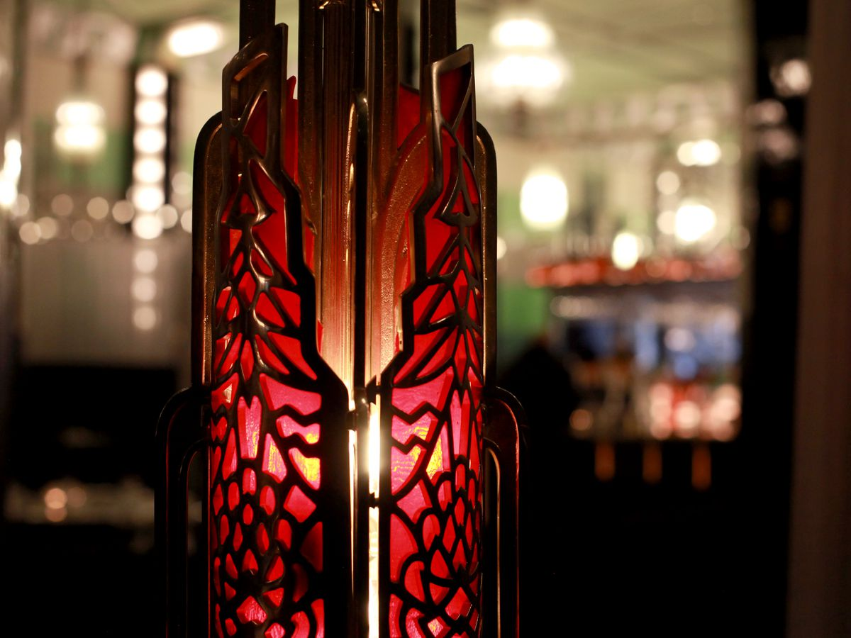 A closeup of a Tiffany light fixture inside the dining room at Fhima's