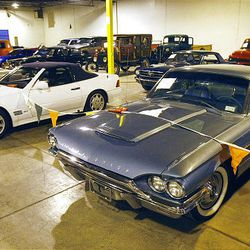A variety of cars stand on display for auction at the U.S. marshals auction Thursday. The marshals held an auction to sell off the $6 million worth of cars, boats and motorcycles of Jeffery Mowen, who is accused of operating a Ponzi scheme.