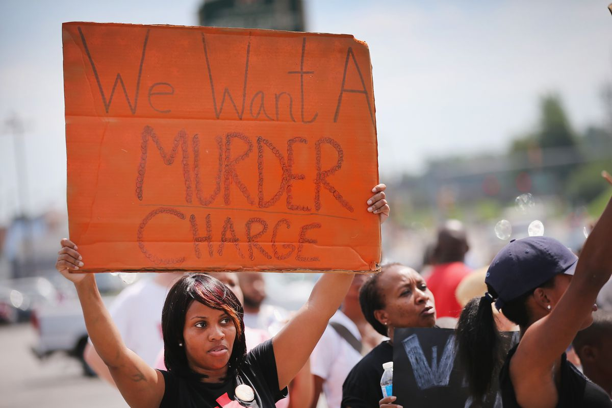 A demonstrator holds up a sign in Ferguson, Missouri.