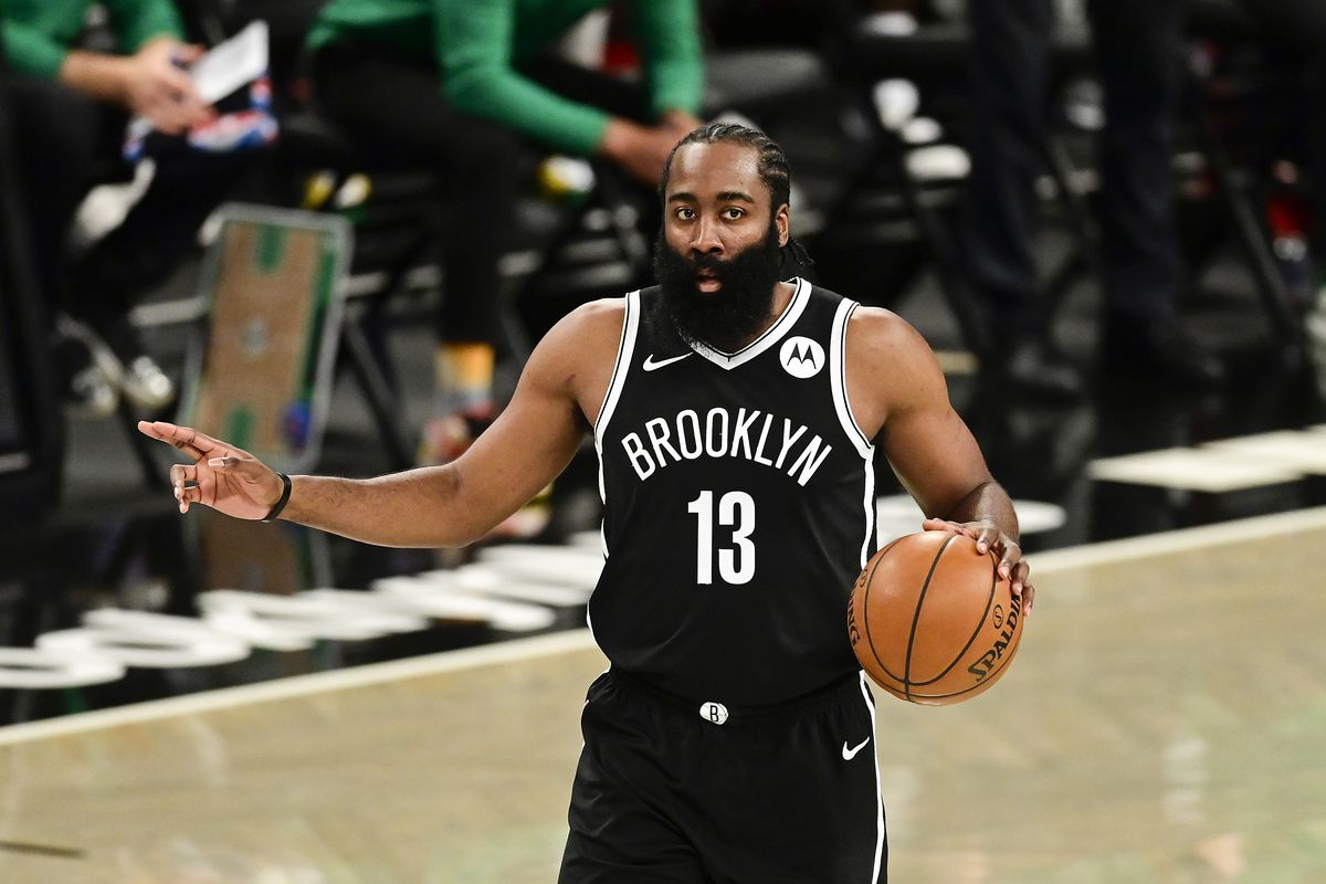 James Harden of the Brooklyn Nets handles the ball against the Boston Celtics in Game One of the First Round of the 2021 NBA Playoffs at Barclays Center at Barclays Center on May 22, 2021 in New York City.