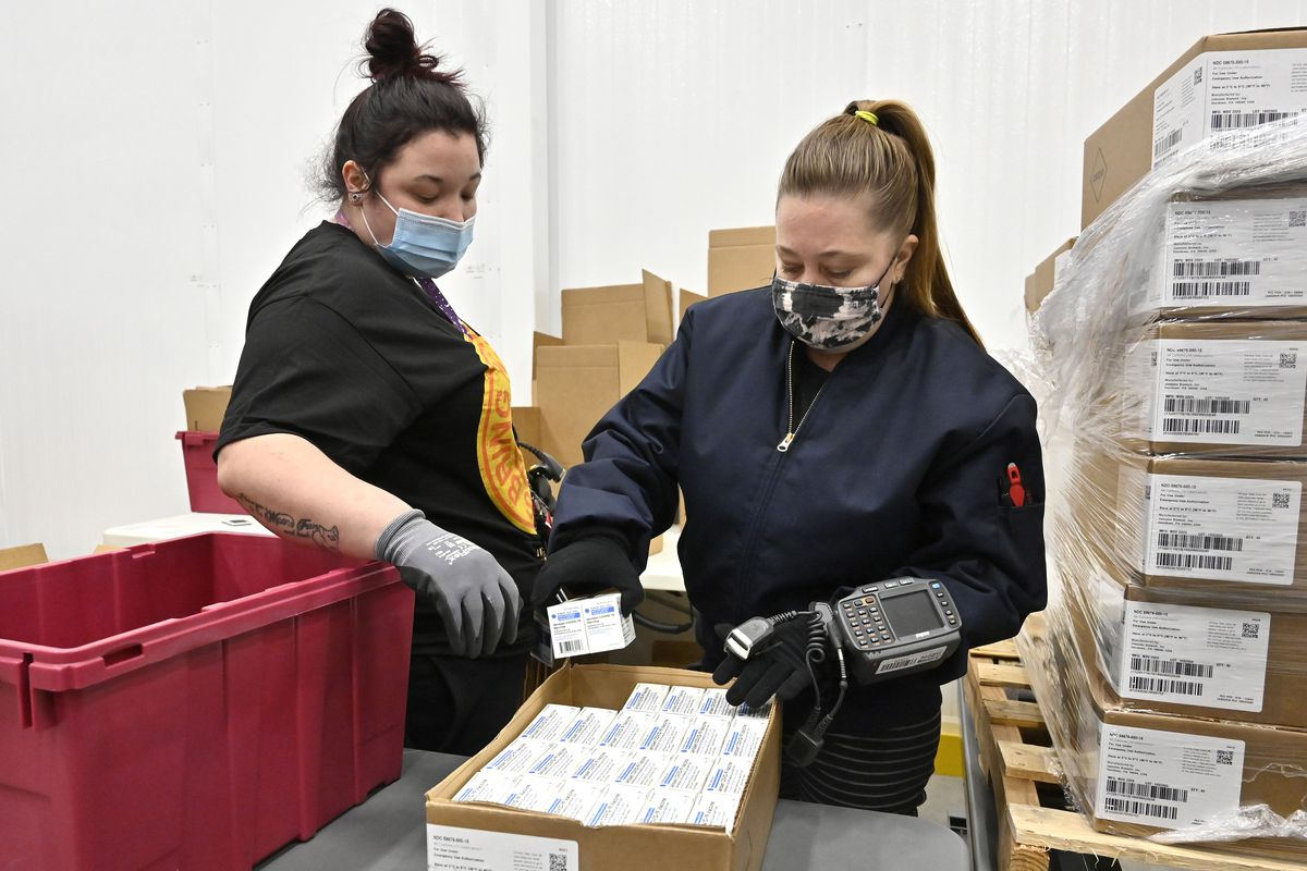 An employee with the McKesson Corporation scans a box of the Johnson & Johnson Covid-19 vaccine as she fills an order at their shipping facility on March 1, 2021, in Shepherdsville, Kentucky.