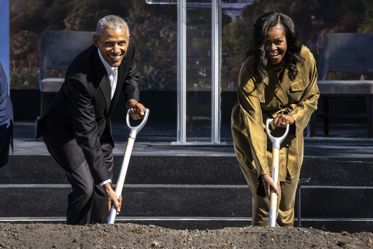Former President Barack Obama and first lady Michelle Obama break ground for the Obama Presidential Center in Jackson Park on Tuesday.