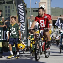 Green Bay Packers' Taysom Hill rides a bike to NFL football training camp Thursday, July 27, 2017, in Green Bay, Wis.