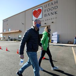 Gov.-elect Spencer Cox and his wife, Abby, walk to their vehicle after they and Lt. Gov.-elect Deidre Henderson and members of their families volunteered at the Utah Food Bank in St. George on Saturday, Jan. 2, 2021.