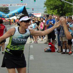 Elfi Ortenburger cheering on marathon runners.