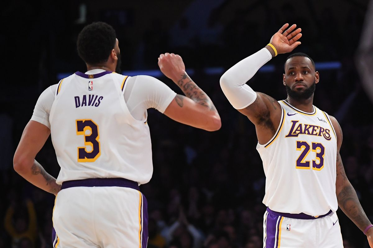 Los Angeles Lakers forward Anthony Davis gets a high five from forward LeBron James after scoring his 50th point of the game in the second half against the Minnesota Timberwolves at Staples Center.