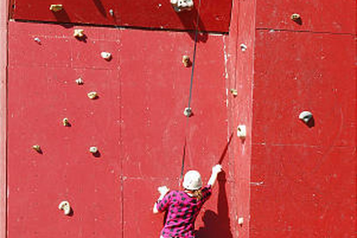 An Operation Military Kids camp participant climbs a rock wall at Zion Ponderosa Ranch & Resort in Kane County.