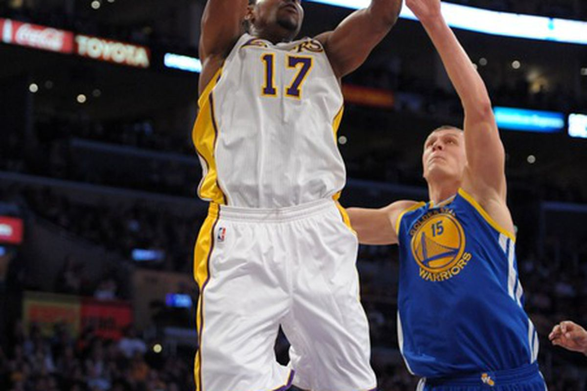 Apr 1, 2012; Los Angeles, CA, USA; Los Angeles Lakers center Andrew Bynum (17) and Golden State Warriors center Andris Biedrins (15) battle for a rebound at the Staples Center. Mandatory Credit: Kirby Lee/Image of Sport-US PRESSWIRE