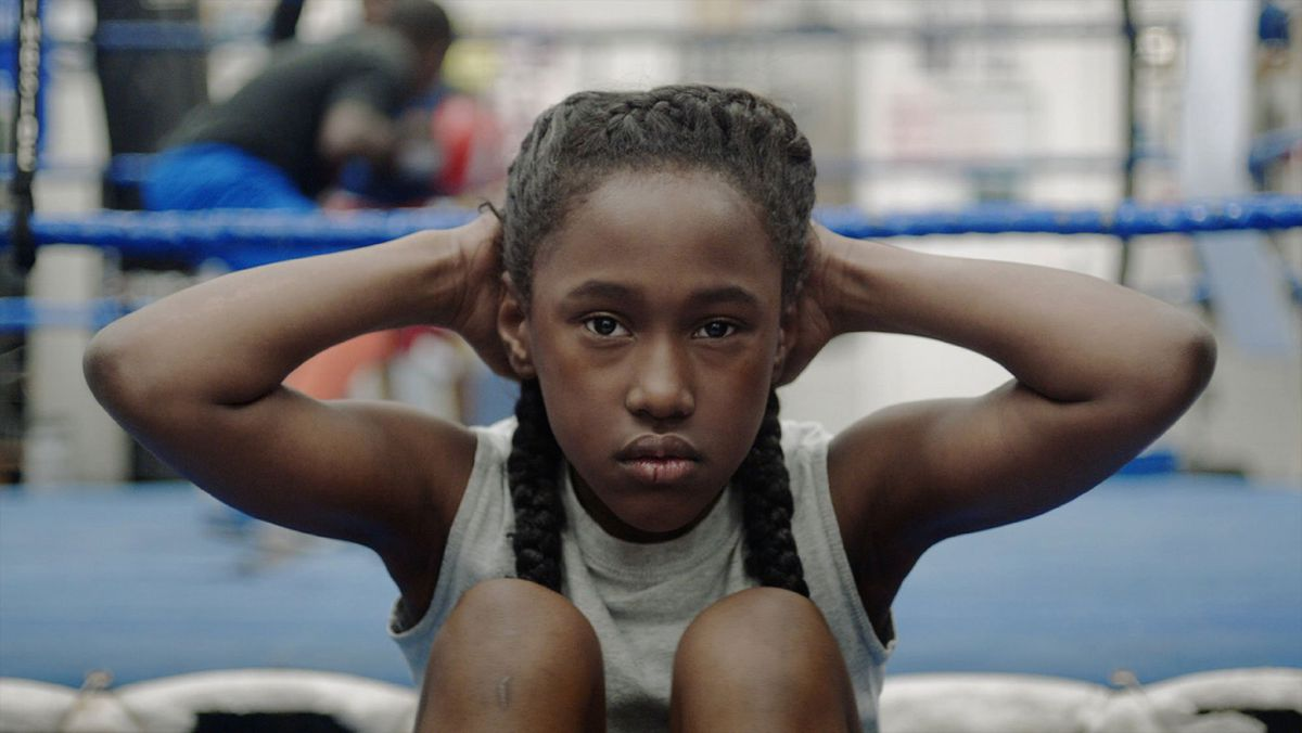 """Royalty Hightower, star of """"The Fits,"""" does crunches in the gym."""