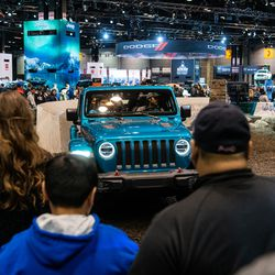A crowds waits in line to test drive Jeep vehicles at the Jeep test driving course Saturday at the 2020 Chicago Auto Show at McCormick Place.