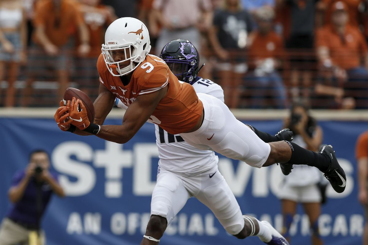 Collin Johnson #9 of the Texas Longhorns catches a pass for a touchdown defended by Jeff Gladney #12 of the TCU Horned Frogs in the third quarter at Darrell K Royal-Texas Memorial Stadium on September 22, 2018 in Austin, Texas.