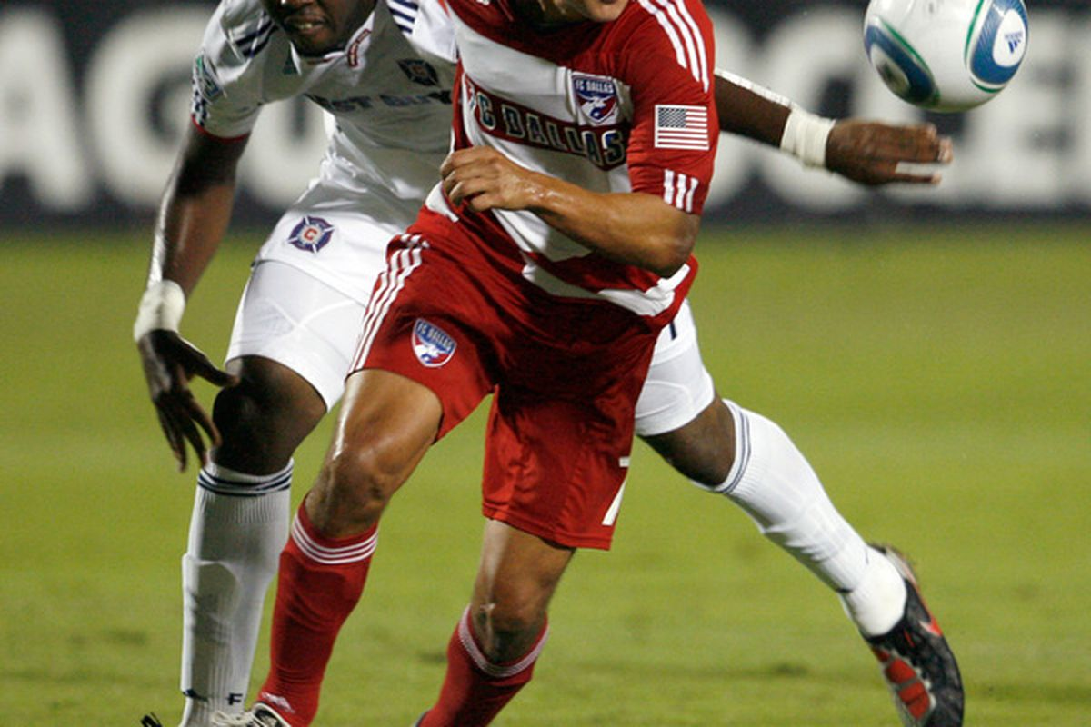 FRISCO TX - OCTOBER 02:  Forward Milton Rodriguez #7 of FC Dallas beats out defender Kwame Watson-Siriboe #4 of the Chicago Fire to score at Pizza Hut Park on October 2 2010 in Frisco Texas.  (Photo by Tom Pennington/Getty Images)