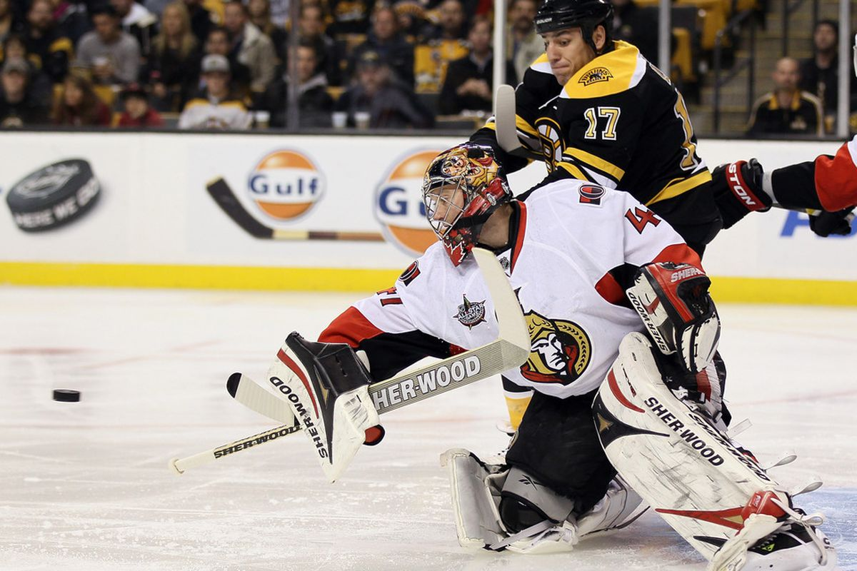 Craig Anderson is seen reaching for a better save percentage here. (Photo by Elsa/Getty Images)