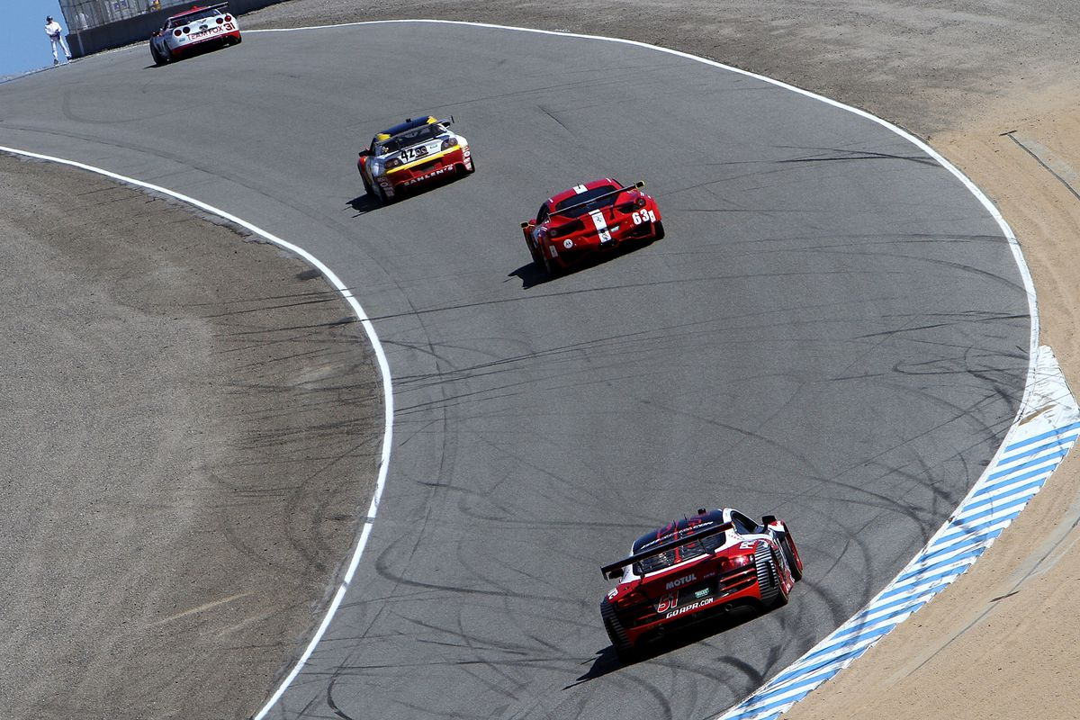 MONTEREY, CA - SEPTEMBER 07:  A pack of GT cars races up a hill during practice for the Continental Tire Sports Car Festival at Mazda Raceway Laguna Seca on September 7, 2012 in Monterey, California.  (Photo by Brian Cleary/Getty Images)