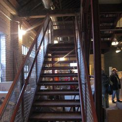Stairs up to the mezzanine level.