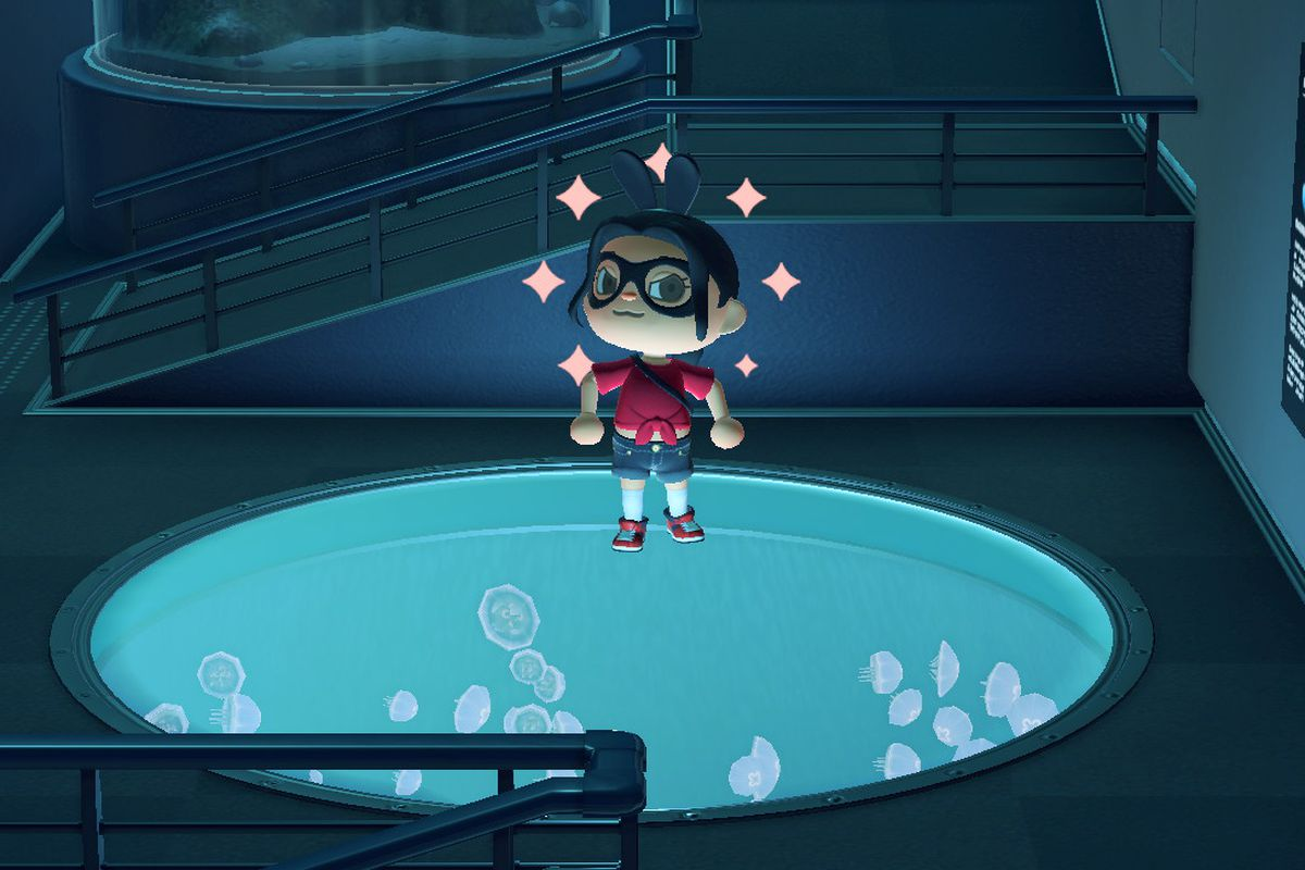 An Animal Crossing character stands proudly over a tank of jellyfish