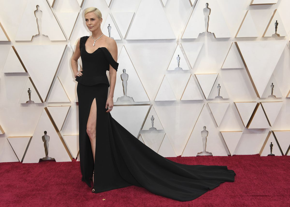 Charlize Theron arrives at the Oscars on Sunday, night wearing Dior Haute Couture.