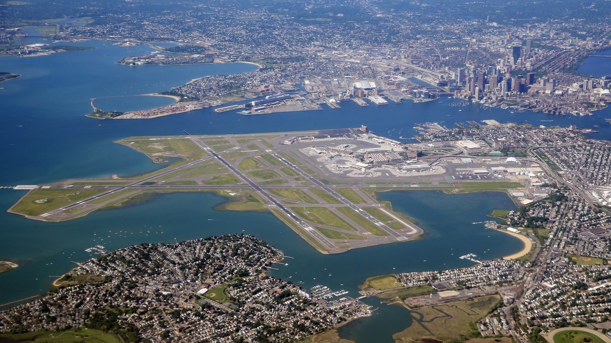 An aerial view of logan airport and the greater boston area as photographed on june 4