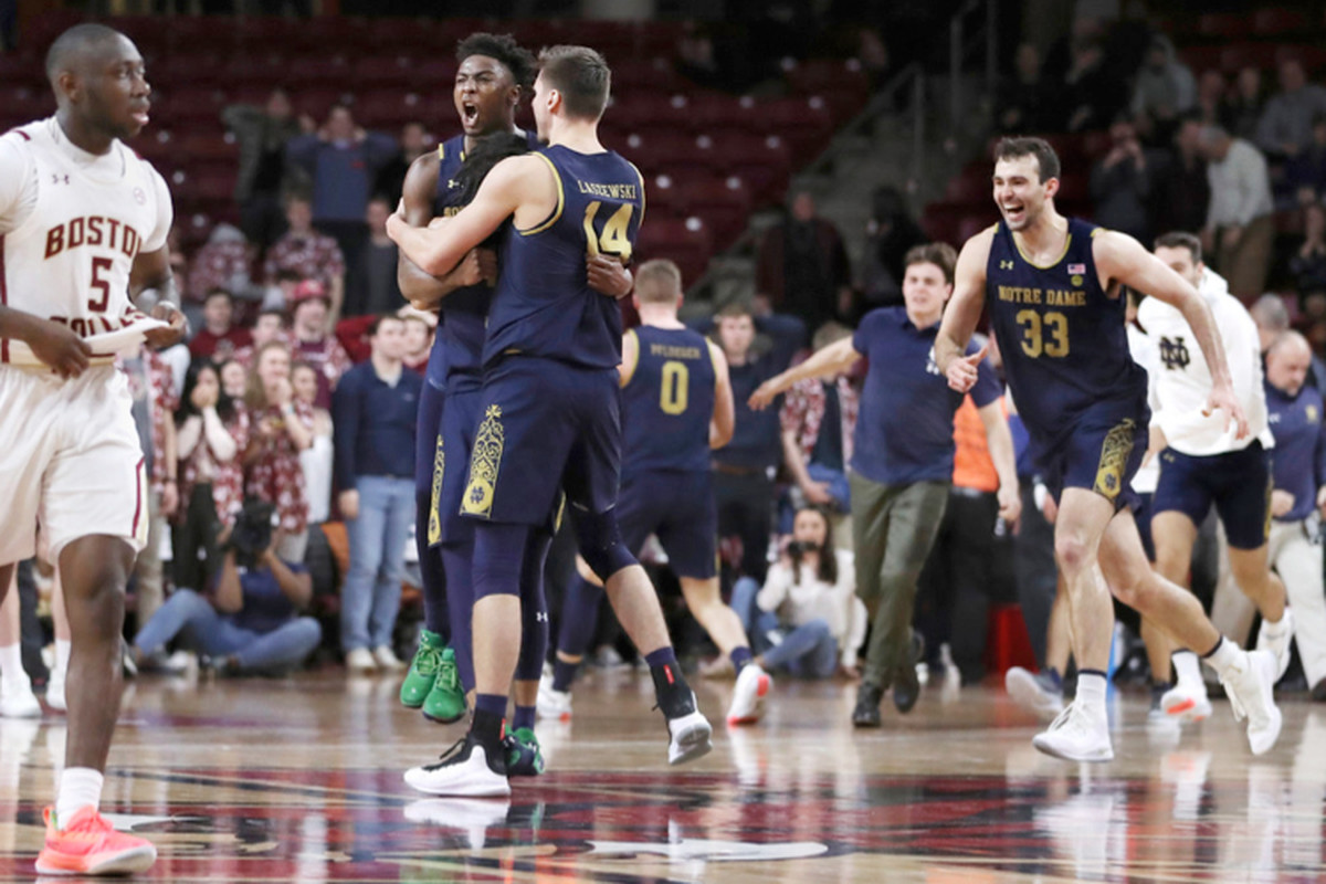 Notre Dame guard TJ Gibbs celebrates with Nate Laszewski (14) after his game-winning basket with 0.1 seconds left on Wednesday.