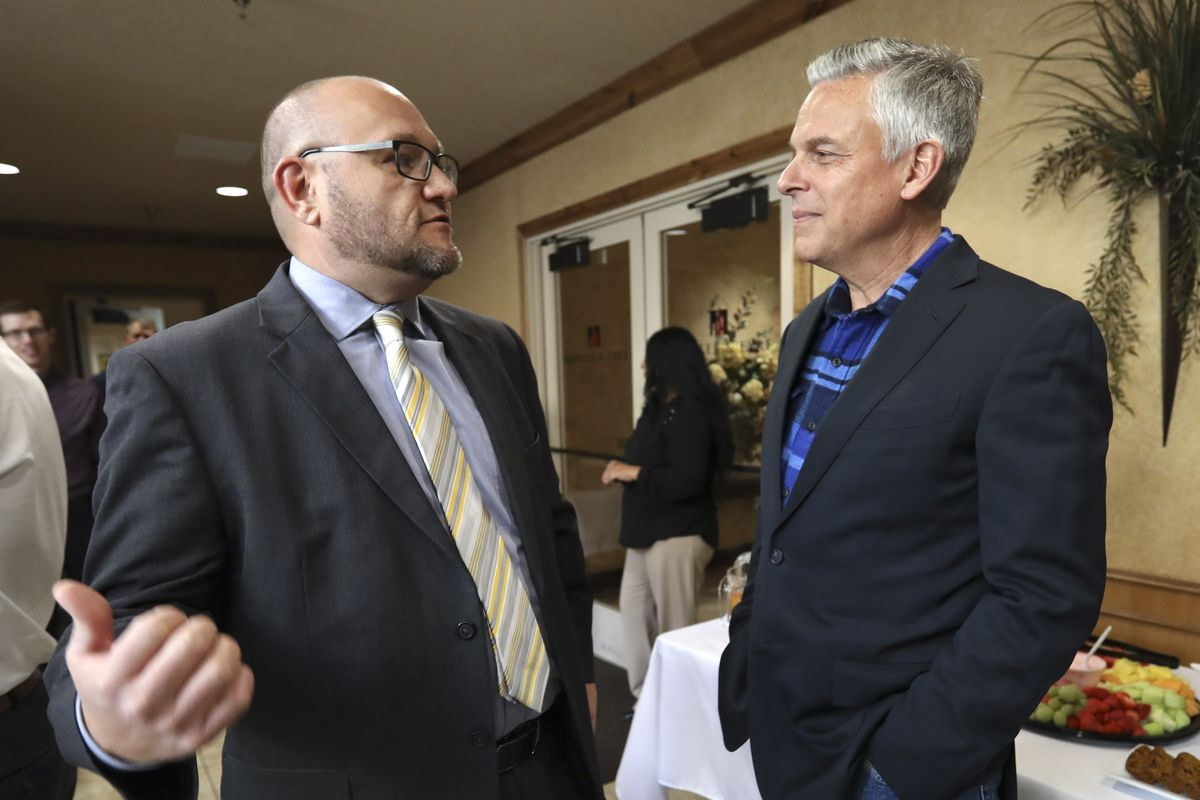 Jon Huntsman Jr., right, talks with Jarom Bergeson, an attorney at KKOS Lawyers, after Huntsman announced he is running for a third term as Utah's governor in Cedar City on Thursday, Nov. 14, 2019.. Huntsman met with employees and clients at KKOS Lawyers and K&E CPAs in their offices on his first campaign stop.