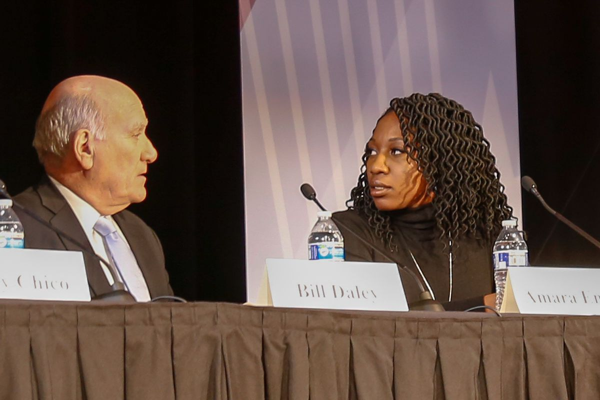 Mayoral candidates Bill Daley and Amara Enyia chat ahead of a forum Thursday evening at Steinmetz College Prep on the Northwest Side. | Nader Issa/Sun-Times
