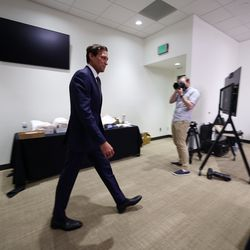 Utah Jazz coach Quin Snyder walks in for an interview during the Utah Jazz media media day at Vivint Arena in Salt Lake City on Monday, Sept. 27, 2021.