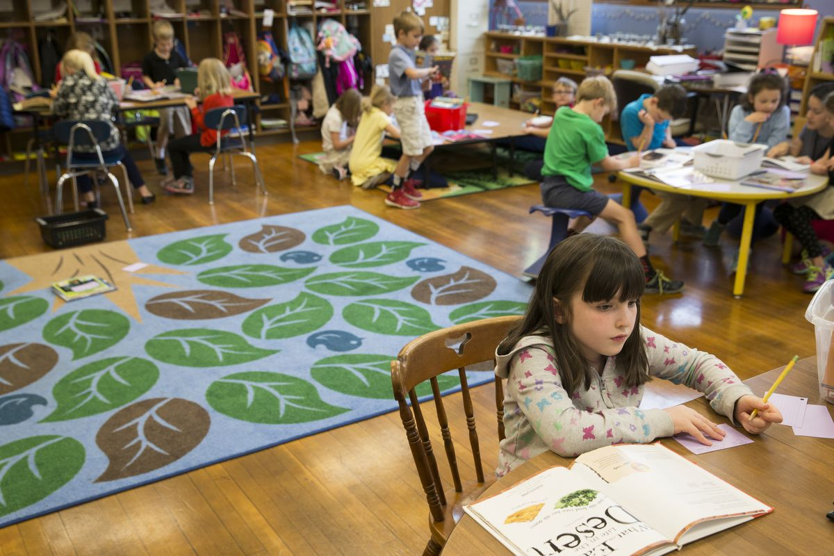 First graders work on coursework at IPS School 84, one of the Center for Inquiry campuses, Indianapolis, Wednesday, May 18, 2016. Ethnically, the Center for Inquiry School 84 is one of the least diverse in the IPS system, and enrollment priority is given to kids living near its Meridian-Kessler location.