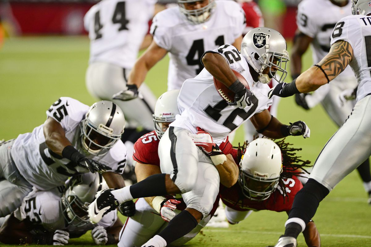 Oakland Raiders wide receiver (12) Jacoby Ford is tackled in the first quarter against the Arizona Cardinals during a preseason game