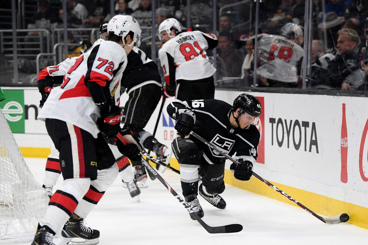 LOS ANGELES, CALIFORNIA - MARCH 11: Blake Lizotte #46 of the Los Angeles Kings reaches for the puck in front of Thomas Chabot #72 of the Ottawa Senators during the second period at Staples Center on March 11, 2020 in Los Angeles, California.