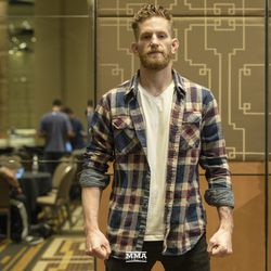 Austin Arnett poses at UFC 234 media day.