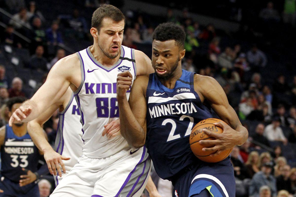 Minnesota Timberwolves forward Andrew Wiggins drives to the basket against Sacramento Kings forward Nemanja Bjelica in overtime at Target Center.