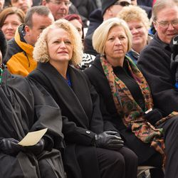 Jackie Biskupski, center left, sits with fiancÉe Betty Iverson, center right, prior to being sworn in as Salt Lake City's first openly gay mayor during a ceremony outside the City-County Building on Monday, Jan. 4, 2016.