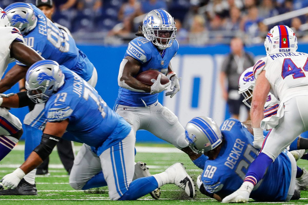 Detroit Lions running back Jamaal Williams (30) runs against Buffalo Bills during the first half of the preseason game at Ford Field in Detroit on Friday, Aug. 13, 2021.