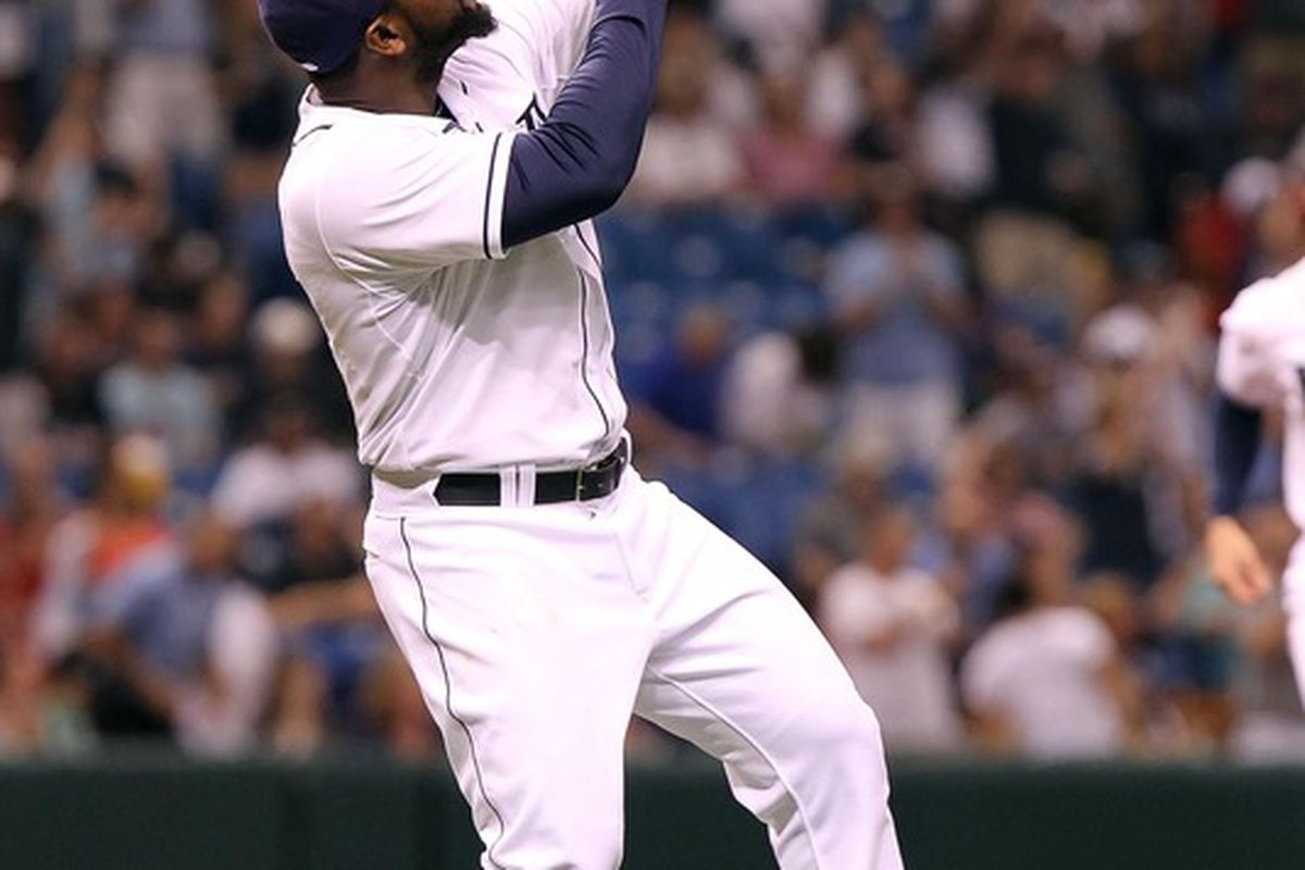 May 19, 2012; St. Petersburg, FL, USA; Tampa Bay Rays relief pitcher Fernando Rodney (56) reacts after they beat the Atlanta Braves at Tropicana Field. Tampa Bay Rays defeated the Atlanta Braves 5-2.  Mandatory Credit: Kim Klement-US PRESSWIRE