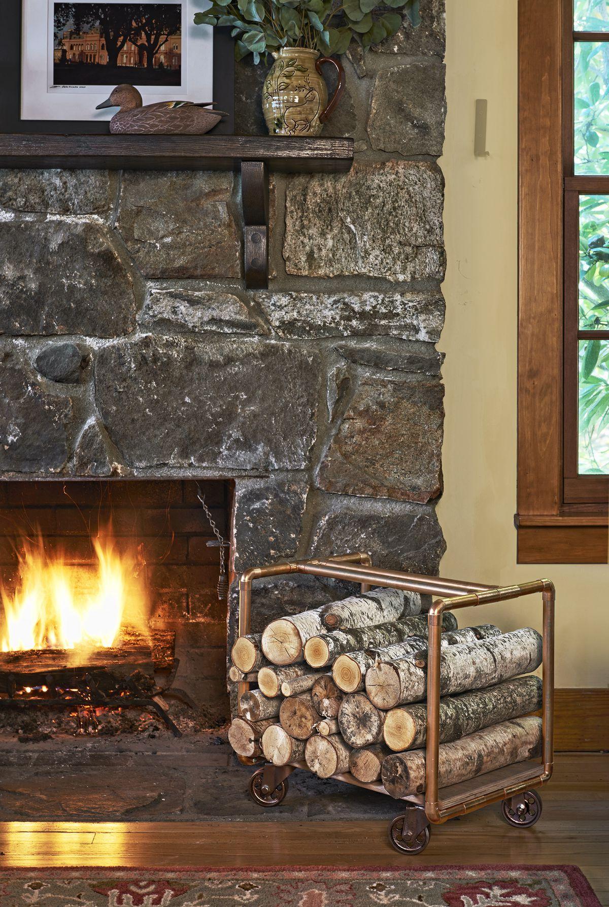 Copper Firewood Holder Near Fireplace
